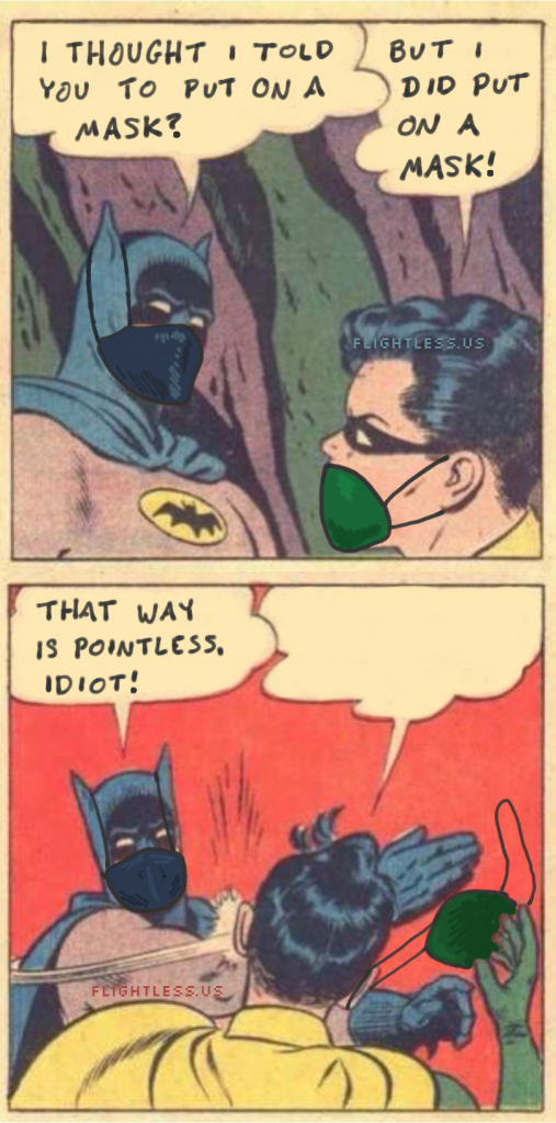Batman slapping Robin for not covering his nose with his medical mask.