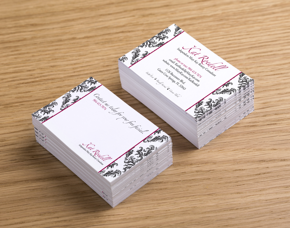 Two stacks of business cards - damask patterns on the sides, text in the middle - black and white with magenta highlights
